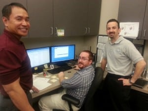 Total Networks employees Marc Bulatao (left) and Tony Fiorentin (right) working together with Davis Miles Help Desk Technician Chris Klingler (center)